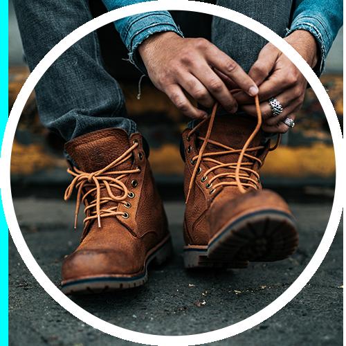 man lacing up hiking boots